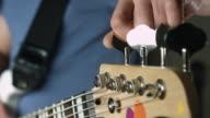 Tune bass guitar close up video