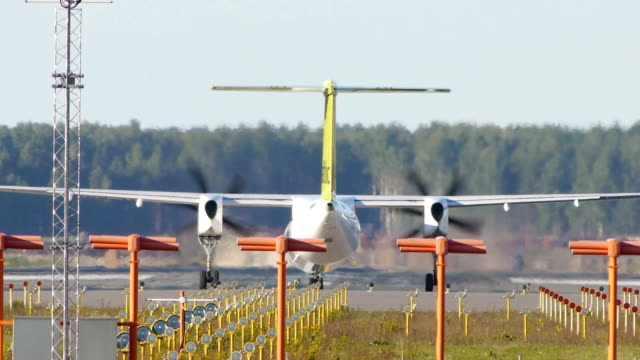 HD - Turboprop aircraft on a runway video