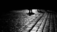 Turist in Cracov, shadows, black and white video