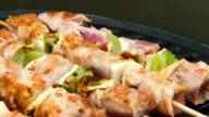Turkey meat on sticks flips on a grill video