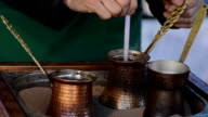 Turkish coffee in hot sand - Stock Video video