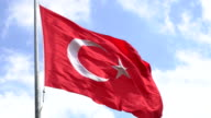Turkish flag blowing in the wind against a blue sky video
