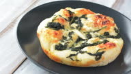 Turkish flat bread with cheese and spinach topping video