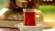 Turkish tea urn and a cup of hot turkish tea video