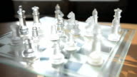 turning and panning: glass chess under sunlight video