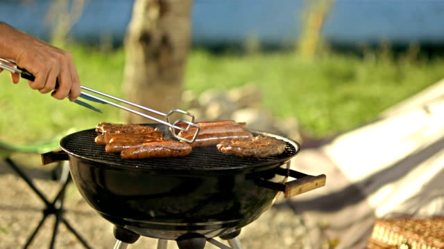 Turning Meat On Barbecue video