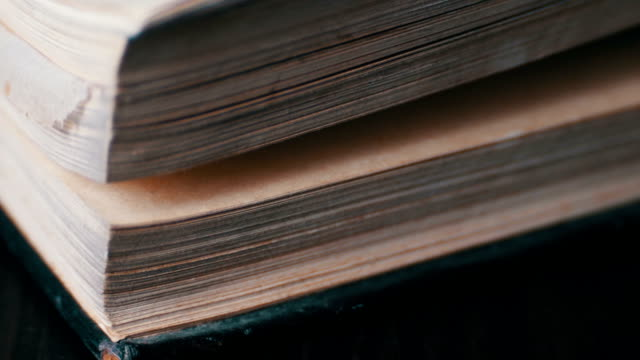 Turning the pages of an old book close-up video