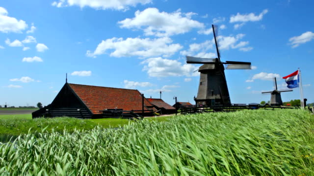 Turning traditional windmill on a sunny day, Schermerhorn, The Netherlands video