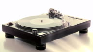 DJ Turntable. Dropping the needle on a spinning vinyl record player. Long-shot. beauty-shot on white background. video