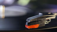 Turntable stylus lowers on to vinyl record and plays, detail, shot on R3D video