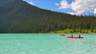 4K Turquoise Lake Louise, Canoes Paddling, Banff Alberta video