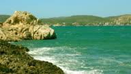 Turquoise water sea bay waves crushing rocky coastline Majorca video