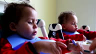 Twin boys eating lunch video