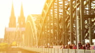 Twin towers of Cologne Dom Cathedral roman Gothic style, symbol of German city Koln, railway bridge, famous cathedral tourist attractions travel sight seeing places in Western Europe, beautiful sunset video