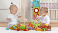 HD: Two Adorable Babies Playing With Toys video