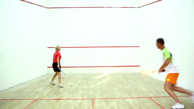 Two adults playing squash. video