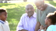 Two African American children with their grandparents video