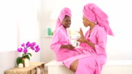 Two African American friends drinking coffee in spa video