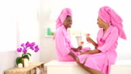 Two African American friends drinking wine in spa video