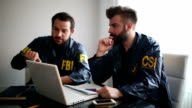 Two agents in the office. FBI and CSI video