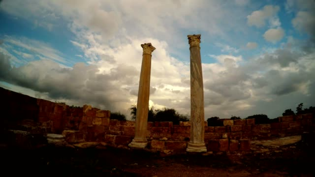 Two antique columns on background blue sky with white clouds Salamis Cyprus video