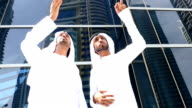 Two arab business people on the street -slowmotion video