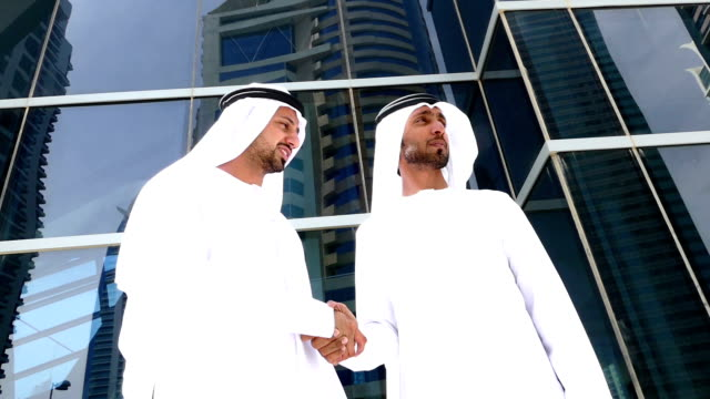 Two arab business people on the street - Stock video video