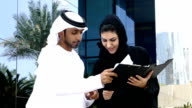 Two arab business people outside - slowmotion video