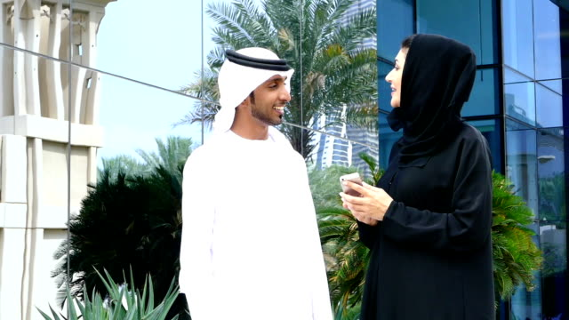 Two arab business people outside video