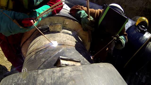 Two Arc Welders Working in a Pipeline video