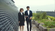 Two Asian Business Partners Walking on a Rooftop video