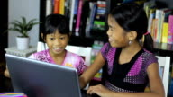 Two Asian Girls Surfing The Internet On Their Laptop video
