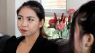 Two Asian Ladies Talking At Work video
