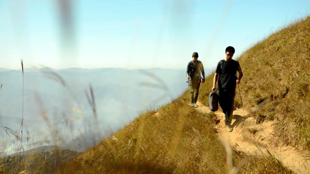 two backpacker men on the edge of mountain video