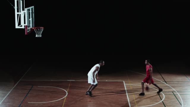 SLO MO of two basketball players playing in free throw lane video