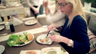Two beautiful girls eating in the restaurant. video