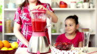 Two Beautiful Little Girls Preparing A Strawberry Smoothie video
