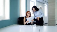 Two beautiful women discuss details conclusion of treaty at office video