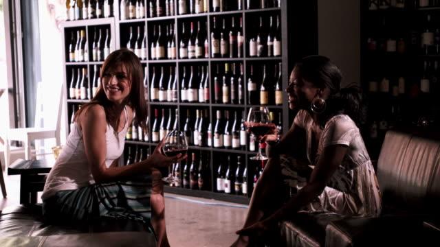 Two beautiful women drinking wine. video