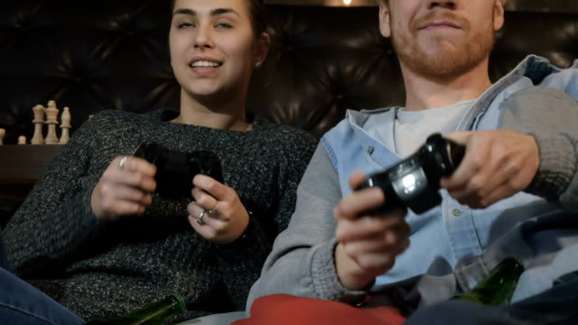 Two best friends playing on the playstation video