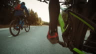 POV Two bikers riding an road through forest video
