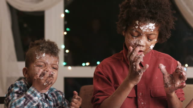 Two black boys destroying cake. video
