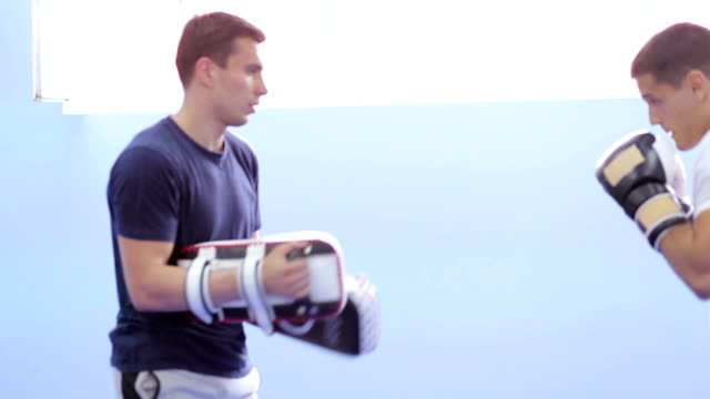 Two boxers fighting in boxing, practicing video