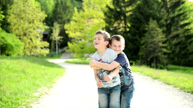Two boys looking at camera. Slow motion. video