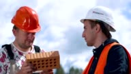 Two Bricklayer or builder or worker build video