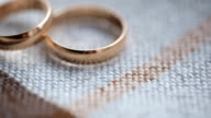 Two bridal rings lie on knitted surface of tablecloth video