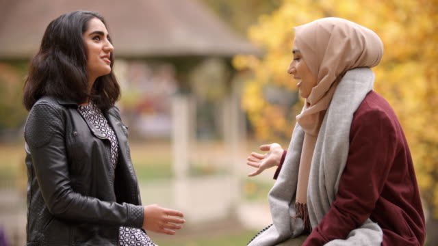 Two British Muslim Women Meeting In Urban Park video