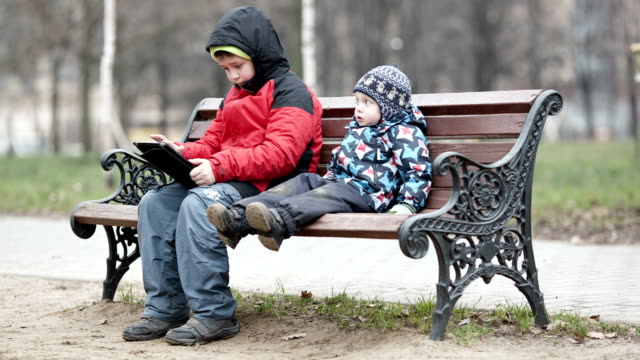 Two brothers with tablet computer video