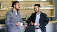 two business colleagues enjoying after lunch video