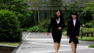 Two business women meeting at the business centre video